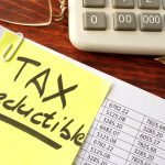 Sticker with title tax deductible and financial documents.